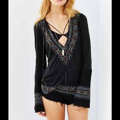 Urban outfitters top This cute top is great for fall! It has detailing along the seams and flowy sleeves. It has ties at the top and is very flattering! Looks great with dark denim! No rips, wholes or stains. Perfect condition! Urban Outfitters Tops
