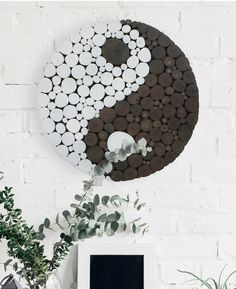 Polka dots made from wooden branches put a fun twist on the ancient Yin Yang symbol. 18 inches in diameter.