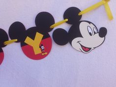 This Mickey Mouse inspired Birthday banner is sure to be the perfect backdrop for your childs Mickey birthday! This order is for one Mickey Mouse themed Happy Birthday banner. This banner is handmade from 1 layers of high quality, acid free cardstock for a durable finish and laced