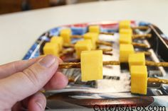 Thor's hammer snacks: pretzels with cheese cube. Cute As a Fox: Marvel Avenger's themed Party