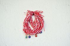 Martis chunky bracelet in red and white with evil by Beh1ndByMK