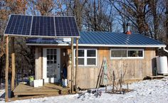 Three photovoltaic panels power our off grid tiny house in NE Missouri | Homestead Honey