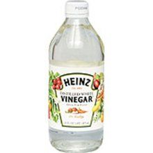 "White Vinegar - any brand - will take the smell of cat urine out of ANYTHING!   It is safe and natural...just put it in your washing machine, use it in sink for a soak, or put it directly on carpet....It works better than any ""pet urine"" branded chemical product I've ever tried....and believe me I've tried them all having dogs and cats."