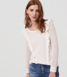 Ruffle trim treats this texturally rich sweater to the perfect touch of feminine frill. Round neck. 3/4 sleeves. Ribbed neckline, cuffs and hem.