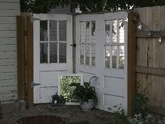 I love this idea of incorporating old doors into a privacy screen or deck wall via homeaway.com
