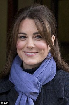 Royal smile: The Duchess of Cambridge beamed as she left the King Edward VII Hospital today