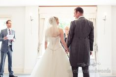 Bride and groom hold hands at Italian Villa Wedding ceremony. Photography by one thousand words wedding photographers