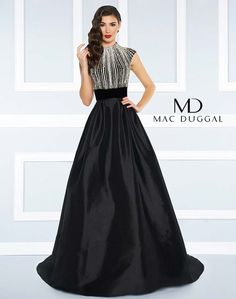 Satin ballgown with velvet, beaded cap sleeve bodice, high neck and open back.
