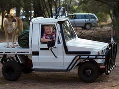 Mini Toyota Land Cruiser with snorkel, spot lamps and flatbed.