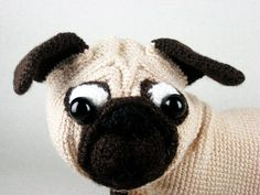 Crocheted stuffed animal Pug  Handmade crocheted with quality acrylic yarn. Toys body is only stuffed and no wires were used. This dog is very soft to touch and cute. This playful and happy pug is wonderful toy for children, will look perfect on your desk or anywhere you would like to keep it. This soft toy is perfect gift or home decoration.  Height: 12cm (4.72) Lenght: 20cm (7.87) Width: 9cm (3.54)  Suitable for children for ages from 3years and older.  Your purchase will be nicely wrapped…