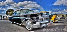 Classic American black Ford Mercury Monterey on display at a car and bike show…