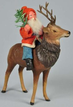 Lot # : 55 - Santa Riding Composition Reindeer Candy Container