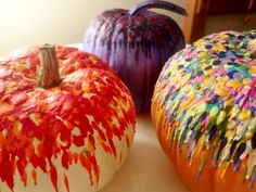 Melt different colored crayons on pumpkins
