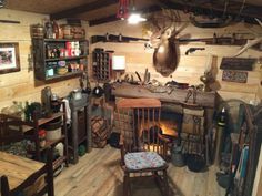 Man turns unused basement room into a log cabin replica. It's hard to imagine this was once a barren colorless room with a disco ball hanging in it.