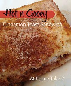Sweeeet! Hot n Gooey Cinnamon Toast Sandwich! Peanut butter +chocolate +marshmallows all melted into a gooey goodness.