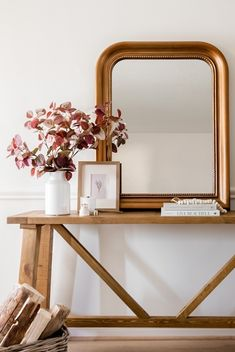 Stumped on how to style your fall console table? Add height and dimension with a vase filled with artificial fall leaves. Trim stems down to fit and enjoy an instant fall refresh. Shop this look at Afloral.com.