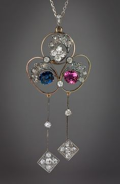 A Belle Epoque Antique Negligee Pendant circa 1900 An elegant openwork 14K gold and silver pendant is set with a cushion-cut sapphire (7.35 x 6 x 4 mm, approximately 1.55 ct),   a pink tourmaline (7.3 x 6.7 x 4.4 mm, approximately 1.35 ct), and old mine and rose cut diamonds (estimated total diamond weight 1.80 ct). Length with bail  79 mm (3 in.) Width 33 mm (1 1/4 in.)