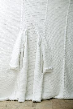 White jacket within a fiber installation made by Isabel Berglund.