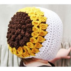 This listing is for a crochet pattern for The Susannah Bonnet, part of my Prairie Home Collection.This is truly one my my favorite patterns, inspired by my late summer baby. A striking, textural sunflower motif cover the entire back of the bonnet, and is finished with a simple, crisp frame around that cute little face. I love the country simplicity of this bonnet-it would make a great shower gift, or a unique Easter bonnet.All patterns written in standard US terms.Sizes (all included in…