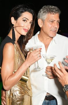 Pin for Later: This Might Be the Sexiest Dress Amal Clooney Has Ever Worn  She accessorized with just the right pieces — black tassel earrings and a simple matching clutch.