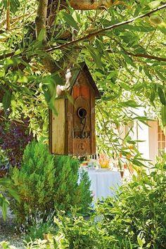 Rustic Birdhouse and pretty garden!