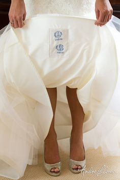 The bride and groom's initials were stitched into this wedding dress   Andre LaCour Photography
