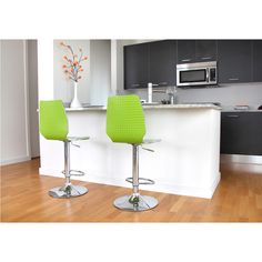 A unique shape and sleek chrome edging are the perfect complements to the bold and modern color of the Danata bar stool. With a back finished in lenticular material, this seat will add a touch of contemporary style to your home.