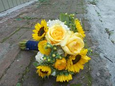 sunflowers, yellow ranunculus,white hydrangeas, green hypericum and cream de la cream roses