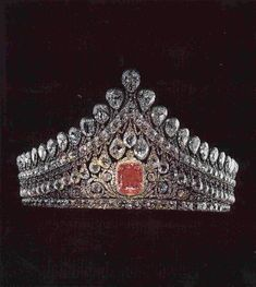 The Romanov Imperial wedding diadem, which was made for the Empress Elisabeth Alexeievna. It is made from over a thousand diamonds with a beautiful 13 carat pink diamond ornamenting the centre.