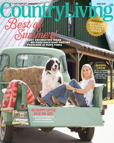 Sheryl Crow sits in her mint green 1951 Chevy pickup truck with Benji Nashville property.