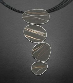 by Carla Pennie McBride. Sterling silver pendant with poured resin encapsulating forged gold fill and silver wire, on a fine silver neck chain with tube clasp. Approx 16