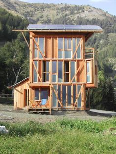 The small tower house with 3 bedrooms in 839 sq ft combines a rustic look with leading edge energy efficiency. | www.facebook.com/SmallHouse...