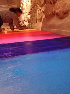 Painting the floor for the childrens rainbow walk in Muserum childrens museum, Roskilde, Denmark.