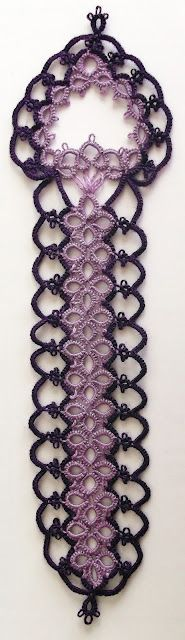 .I like the plain, straight part best, without the pointy bit on top. Cute bookmark, though..... This is a pretty lace pattern, but it is a little phallic! It's like a bachelorette favor for book worms.