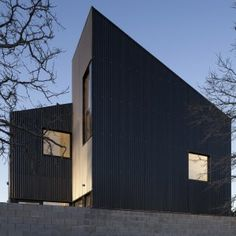 Galvez+Autunno+creates+black+housing+blocks+with+jagged+rooflines+in+Patagonia