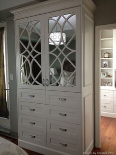 Custom wardrobe built-in for a client's master bedroom. Swarovski crystal hardware completed this glamorous look!
