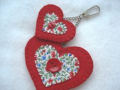 http://www.berrynicecushions.co.uk/ourshop/prod_2072451-Red-Felt-and-Fabric-Heart-Bag-Charm.html