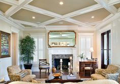 beautiful family room, coffered ceiling, fireplace flanked by windows.