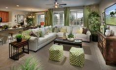 We love the pops of green used to decorate this living space from Lennar Las Vegas. What are your thoughts?