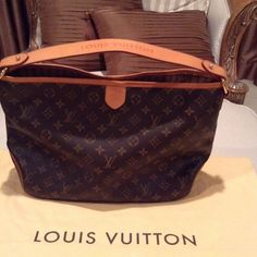 AUTH LOUIS VUITTON DELIGHTFUL MM Gorgeous!! This Delightful Monogram MM embodies everyday elegance! In supple yet resistance Monogram canvas, it's lightweight feel, generous interior and luxurious soft embossed handle make it chic yet practical! Guaranteed authentic! In ABSOLUTE PERFECT CONDITION!!  The natural cowhide leather trim is still in its original color and hasn't darkened. One interior pocket with D ring. Orig price is $1390 plus tax! No trades, please don't ask. Price is firm for…