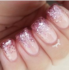 Pink glitter on nude nails