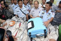 The first proof of the fate of AirAsia Flight 8501 emerged Tuesday from the shallow, aqua-colored waters of the Java Sea.