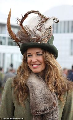 A woman looked striking in an elaborately decorated hat. Race Day Fashion, Races Outfit, Country Casual, Green Hats, Colorful Feathers, Royal Ascot, Anglo Saxon, Thigh High Boots, Fur Trim
