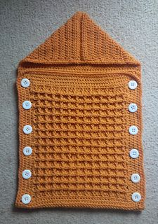 Hooded, button-up baby sleep sack in a tangerine orange yarn. The pattern uses a handsome waffle stitch. Materials: 3 balls of Patons Tangerine Baby Knitting Patterns, Crochet Patterns, Crochet Cocoon, Trendy Baby Boy Clothes, Waffle Stitch, Baby Boy Blankets, Crochet Bebe, Sleep Sacks, Baby Swaddle