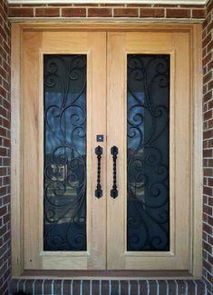 Puleo. Wood and Wrought Iron Door
