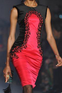 Jason Wu. Beautiful dress, but it slightly resembles a bloody pad. JS