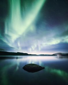 A reflected view of the Northern Lights in Kilpisjärvi, Finland. I love how you can see different rock formations as patterns or even… Special Images, Rock Formations, Beautiful Sky, Vincent Van Gogh, Aurora Borealis, Stargazing, Finland, Northern Lights, Places
