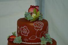 Wedding cake detail with hydrangeas and green cymbidium orchids