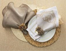 Gray will be implemented in simple linen tablecloths. The off-white plates used will have a sparkling gold border. Napkins will alternate in colour, either being off-white or gray. Each napkin will be fastened with a gold clip, matching the gold border on the plates.
