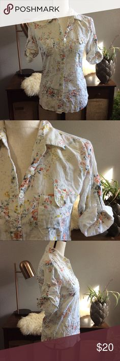 Floral Button Up size 4 half sleeve white rosette Basic button up from shescool size 4 true to size in a gorgeous floral print. Sleeves are 3/4 length when unrolled and half sleeve when rolled up. Excellent condition free of stains tears and holes. Made of 100% cotton. She's Cool Tops Button Down Shirts
